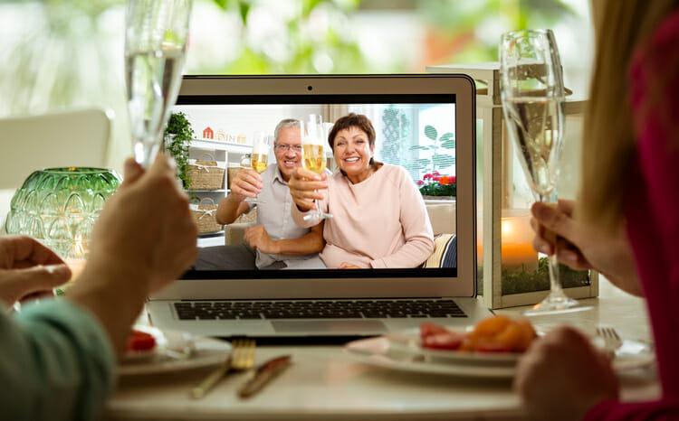 man and woman holding champagne