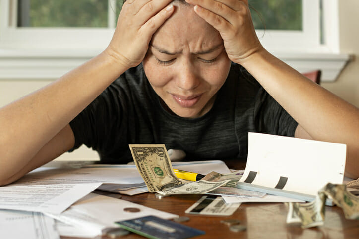 woman upset over paying late fees